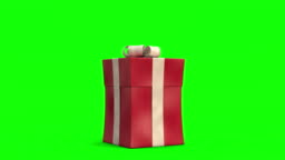 Santa Claus sneaks across and snaps to pop up a big present. Green-screen version