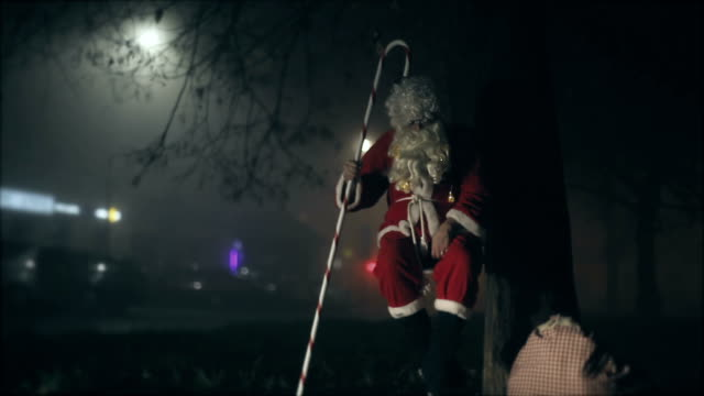 santa claus swinging on swing at night, sack with gifts, stick, tree, chrismtas, gift, city, night - sack stock videos & royalty-free footage