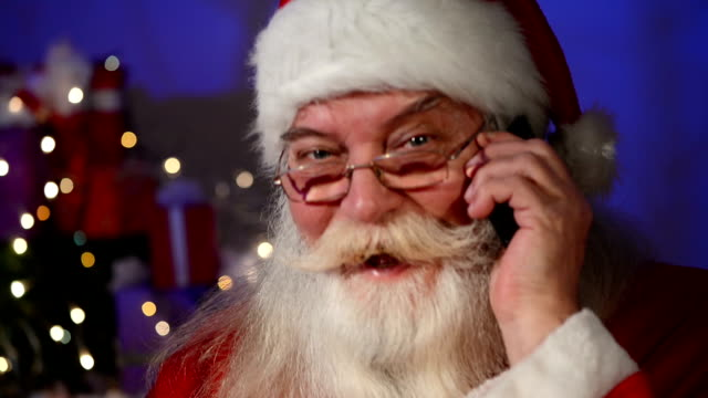 Santa Claus talking on cell phone