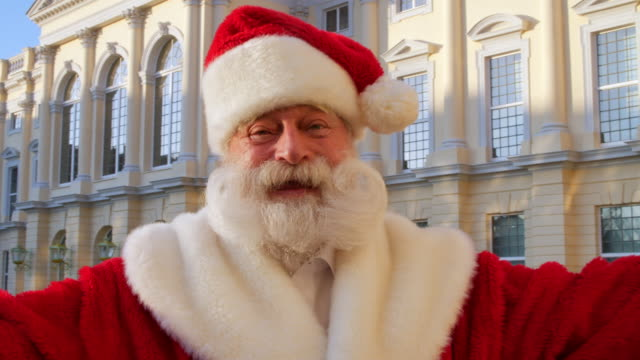 santa claus talking to camera in front of charlottenburg palace - charlottenburg palace stock videos & royalty-free footage