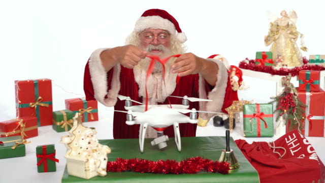 santa claus tie ribbon on drone for christmas  present - leisure games stock videos & royalty-free footage