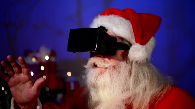 santa claus using a virtual reality headet - christmas present stock videos and b-roll footage