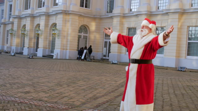 santa claus with arms outstretched in front of charlottenburg palace - charlottenburg palace stock videos & royalty-free footage