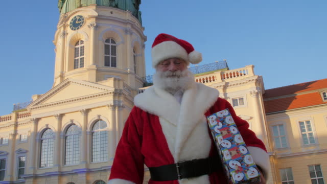 santa claus with christmas gift in front of charlottenburg palace - charlottenburg palace stock videos & royalty-free footage