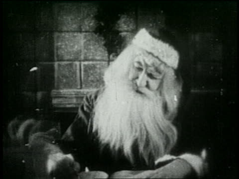 b/w 1925 santa claus writing with quill pen - 1925 stock videos & royalty-free footage
