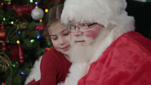 santa clause hugs young girl and gives her a candy cane - candy cane stock videos & royalty-free footage