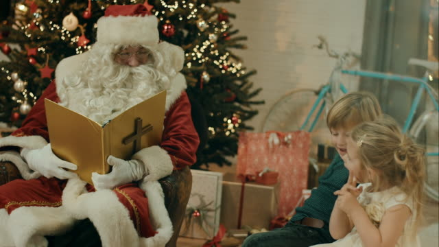 Santa Clause telling stories to kids
