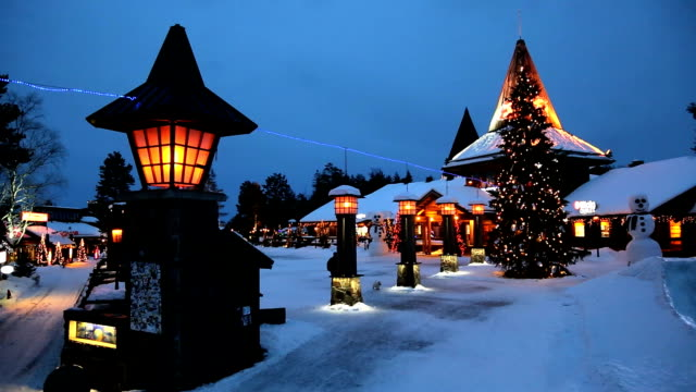 santa clause village illuminated arctic circle rovaniemi finland - finlandia video stock e b–roll