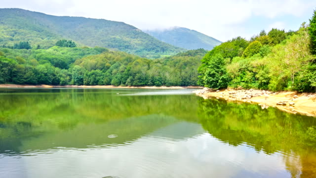 santa fé water reservoir time lapse - barcelona, montseny - reservoir stock videos and b-roll footage