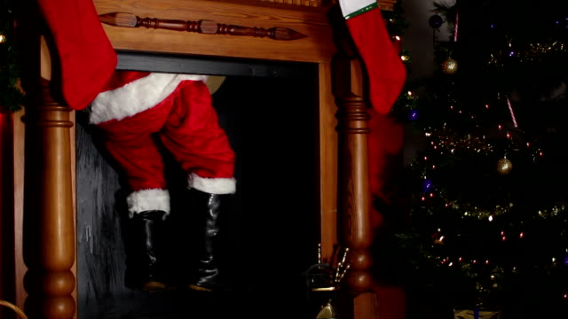 santa / father christmas coming down the chimney - fireplace stock videos and b-roll footage