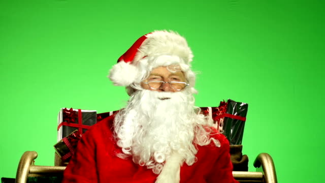 Santa / Father Christmas in Sleigh with Green screen behind