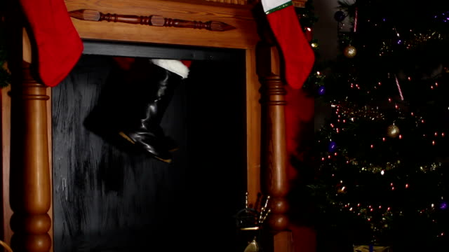 santa / father christmas stuck in the chimney - father christmas stock videos and b-roll footage