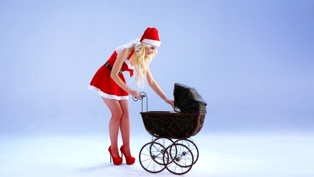 Santa Girl calms crying baby
