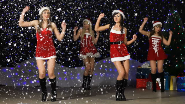santa girl's dancing and showing number 2010 - cheerleader stock videos and b-roll footage
