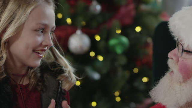 santa hands girl a candy cane as they talk - candy cane stock videos & royalty-free footage