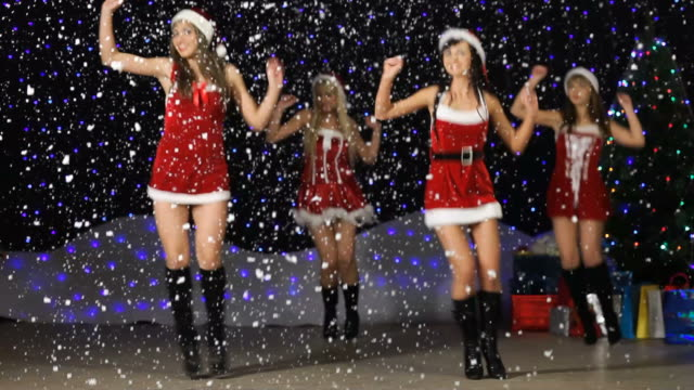 "santa helper's dancing and showing sign ""happy new year"" - cheerleader stock videos and b-roll footage"