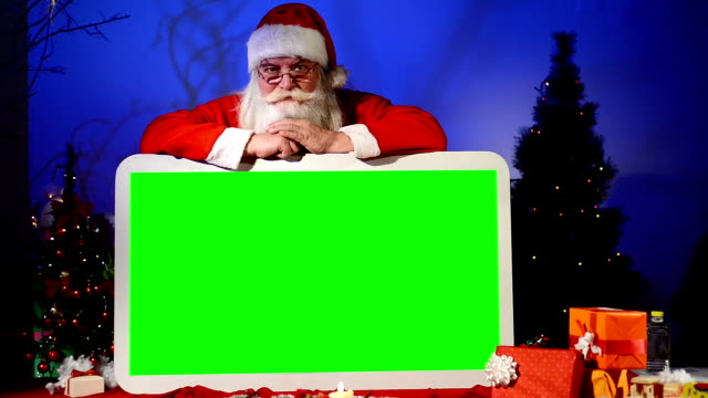 Santa holds empty green sign