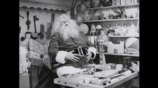 1939 santa laughs happily in his workshop - christmas cracker stock videos and b-roll footage