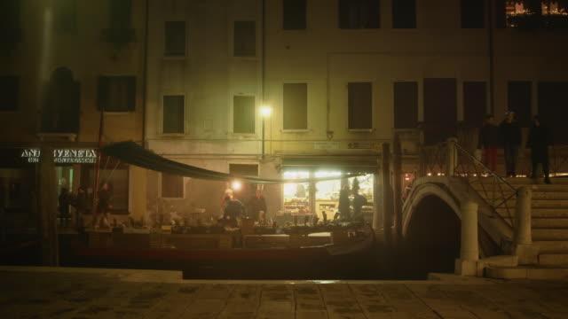 ws - santa margherita square at night, people walking by - liguria stock videos & royalty-free footage