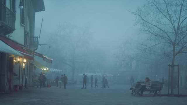 MS - Santa Margherita square in the mist, kids playing in the background