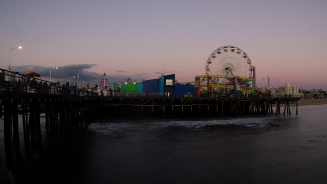Santa Monica amusment park day to night by ocean