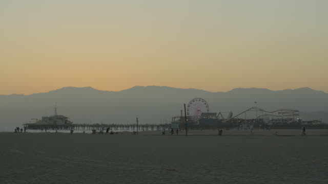 santa monica beach and pier at sunset - santa monica pier stock videos & royalty-free footage