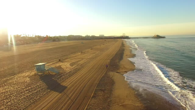 aerial santa monica beach at sunrise - bagnino video stock e b–roll