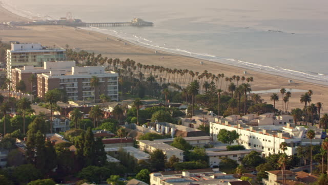 aerial santa monica beach with the pier in the background - santa monica pier stock videos & royalty-free footage