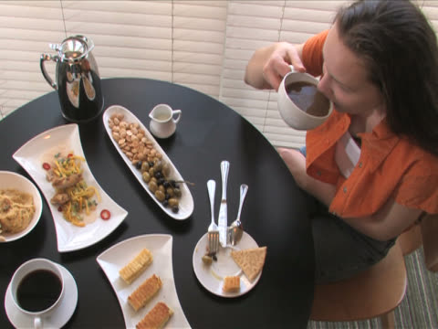 santa monica, california, usaone young woman is having breakfast in the room - breakfast room stock videos & royalty-free footage
