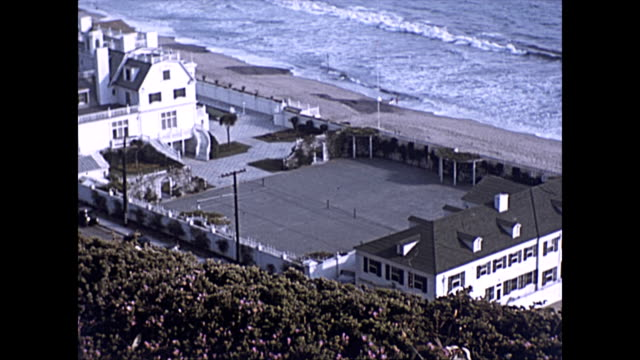 santa monica coastline properties including the william randolph hearst & marion davies beach house - now annenberg community beach house - surfing stock videos & royalty-free footage