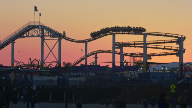 santa monica pier at sunset - wide shot stock videos & royalty-free footage