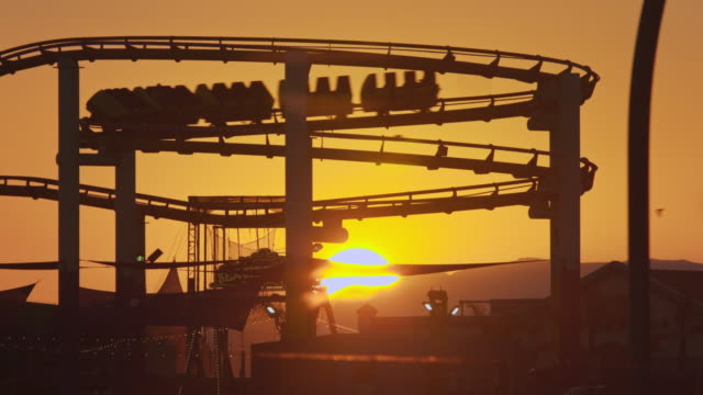 santa monica pier at sunset - santa monica pier stock videos & royalty-free footage