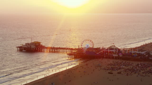 aerial santa monica pier, ca at sunset - city of los angeles stock videos & royalty-free footage