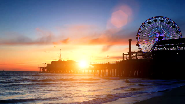 santa monica pier during sunset - ferris wheel stock videos & royalty-free footage