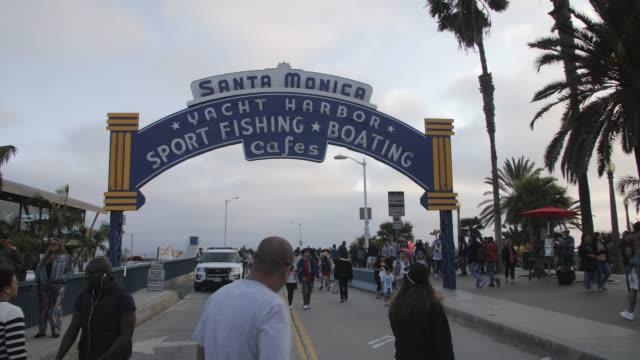santa monica pier entarance sign, pacific park, beach, santa monica, los angeles, la, california, united states of america - santa monica sign stock videos & royalty-free footage