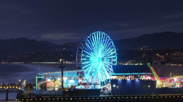 santa monica pier illuminated at night - aerial - amusement park stock videos & royalty-free footage
