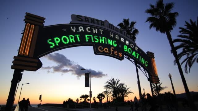 ms santa monica pier neon sign at sunset / santa monica, california, united states - santa monica pier sign stock videos & royalty-free footage