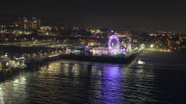 santa monica pier night aerial - santa monica pier stock videos & royalty-free footage