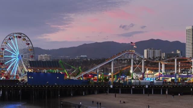 santa monica pier on pastel colored sunset - aerial - establishing shot stock videos & royalty-free footage