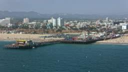 AERIAL Santa Monica Pier with Downtown Santa Monica in California