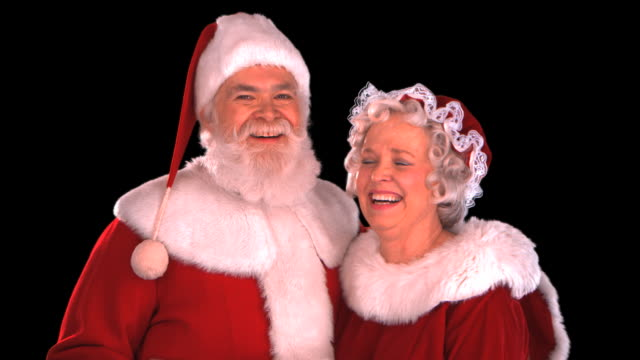 santa & mrs. claus close-up - this clip has an embedded alpha-channel - weihnachtsfrau stock-videos und b-roll-filmmaterial