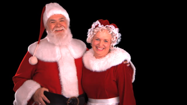 santa & mrs. claus - this clip has an embedded alpha-channel - weihnachtsfrau stock-videos und b-roll-filmmaterial