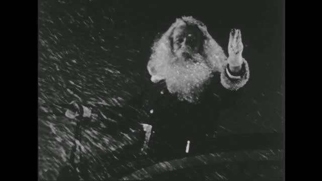 """vídeos de stock e filmes b-roll de 1941 santa on sleigh wishes everyone """"merry christmas"""" - papai noel"""