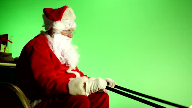 santa sat in sleigh with green screen from side - father christmas stock videos and b-roll footage