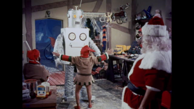 stockvideo's en b-roll-footage met 1964 santa stops a large robot from attacking - werkplaats
