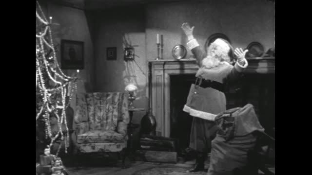 1946 Santa uses magic to decorate Christmas tree before heading back up chimney