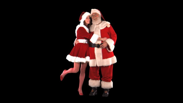 santa with cute elf - this clip has an embedded alpha-channel - pre matted stock-videos und b-roll-filmmaterial