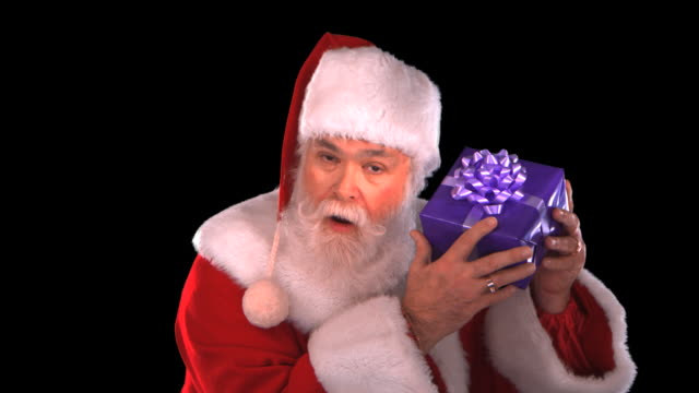 santa with gift - this clip has an embedded alpha-channel - pre matted stock-videos und b-roll-filmmaterial