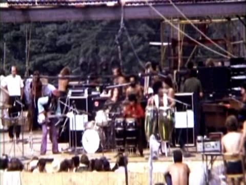 santana playing on stage, fans clapping and dancing to the music. super 8mm home movie footage. - young adult stock videos & royalty-free footage