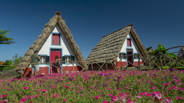 santana traditional houses. madeira, portugal - 4k time lapse - cottage stock videos & royalty-free footage